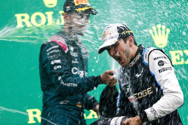 Sebastian Vettel, Aston Martin, 2nd position, sprays Esteban Ocon, Alpine F1, 1st position, with Champagne