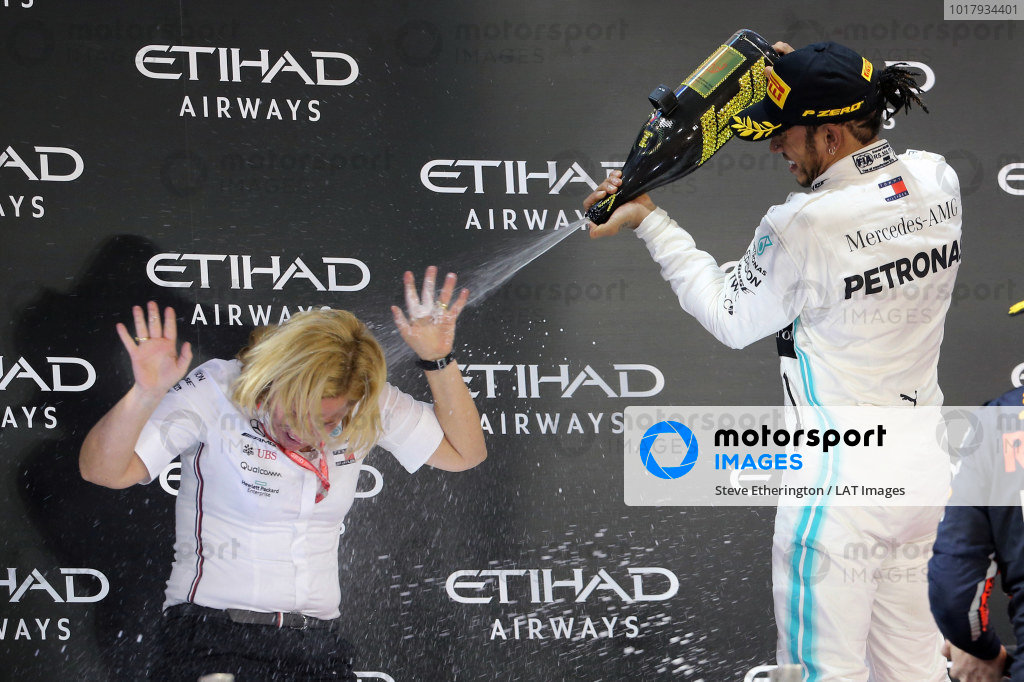 Lewis Hamilton, Mercedes AMG F1, 1st position, sprays his team mate on the podium