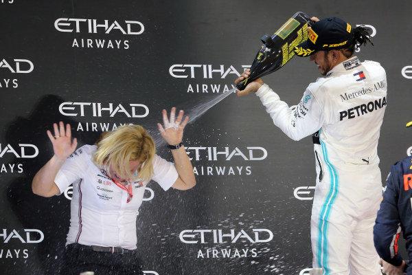 Lewis Hamilton, Mercedes AMG F1, 1st position, sprays his team mate on the podium