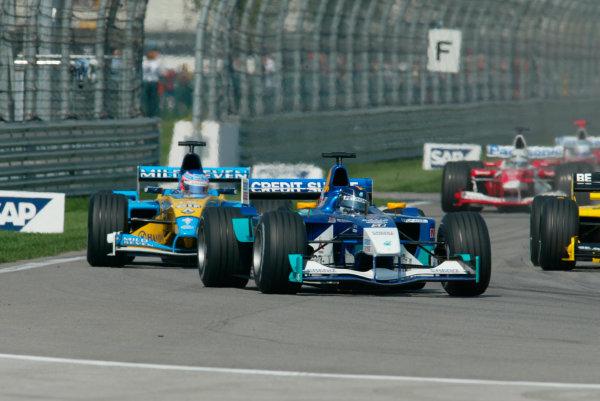 2002 American Grand Prix.Indianapolis, Indiana, USA. 27-29 September 2002.Heinz-Harald Frentzen (Sauber C21 Petronas) followed by Jenson Button (Renault R202).World Copyright - LAT Photographicref: Digital File Only