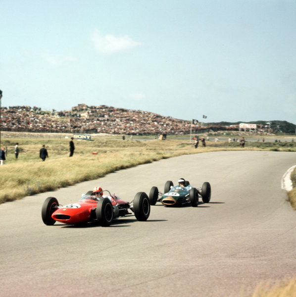 Zandvoort, Holland.21-23 May 1963.Jo Siffert (Lotus 24 BRM) leads Dan Gurney (Brabham BT7 Climax). They finished in 7th and 2nd positions respectively.Ref-3/0966.World Copyright - LAT Photographic