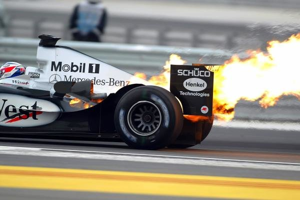 Kimi Raikkonen (FIN) McLaren Mercedes MP4/19 retires from the race with a blown engine. Formula One World Championship, Rd3, Bahrain Grand Prix, Race Day, Bahrain International Circuit, Bahrain, 4 April 2004. DIGITAL IMAGE BEST IMAGE