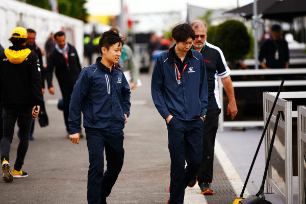 Honda personnel arrive in the paddock.