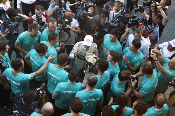 Circuit de Catalunya, Barcelona, Spain. Sunday 10 May 2015. Nico Rosberg, Mercedes AMG, 1st Position, celebrates victory with his team. World Copyright: Sam Bloxham/LAT Photographic. ref: Digital Image _G7C5009