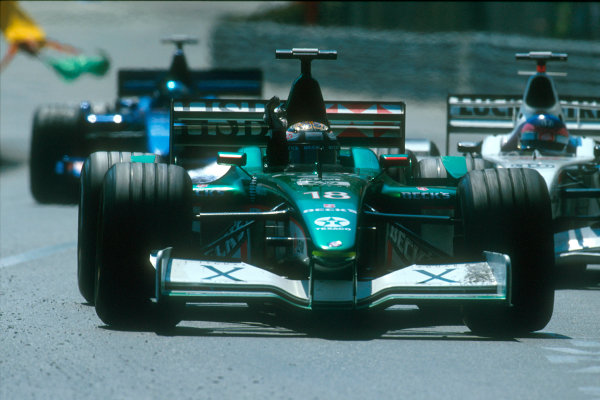 Monte Carlo, Monaco. 29th May 2001. Eddie Irvine, Jaguar R2, celebrates after a points finish in 3rd position.World Copyright: Charles Coates/LAT Photographic ref: 35mm Priority Image 01MON13