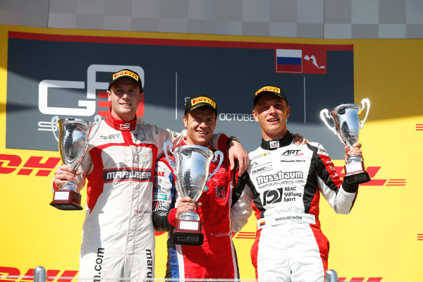 2014 GP3 Series. Round 8.   Sochi Autodrom, Sochi, Russia. Sunday Race 2 Sunday 12 October 2014. Dean Stoneman (GBR, Marussia Manor Racing), Patric Niederhauser (SUI, Arden International) and Marvin Kirchhofer (GER, ART Grand Prix) celebrate on the podium. Photo: Glenn Dunbar/GP3 Series Media Service. ref: Digital Image _89P3046