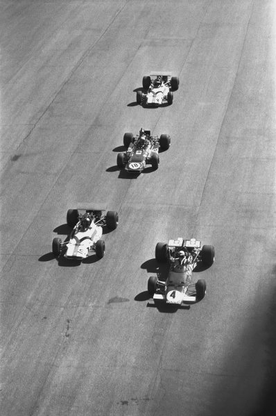 1970 Italian Grand Prix. Monza, Italy. 4th - 6th September 1970. Clay Regazzoni (Ferrari 312B), 1st position, leads Pedro Rogriguez (B.R.M. P153), retired, Jackie Stewart (March 701-Ford), 2nd position and Jackie Oliver (B.R.M. P153), retired, at the start of the race, action. World Copyright: LAT Photographic. Ref: 1346A - 12A.