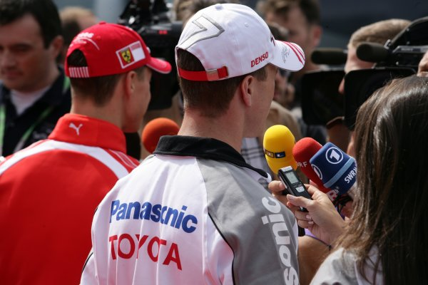 2006 European Grand Prix - Thursday PreviewNurburgring, Germany. 4th - 7th April 2006Michael Schumacher, Ferrari 248 F1 and Ralf Schumacher, Toyota TF106 talk to the media.World Copyright: Charles Coates/LAT Photographic ref: Digital Image ZK5Y0894