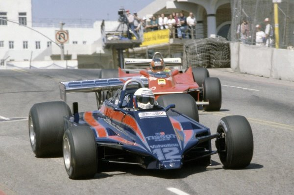 1980 United States Grand Prix West.Long Beach, California, USA. 28-30 March 1980.Elio de Angelis (Lotus 81-Ford Cosworth) leads Gilles Villeneuve (Ferrari 312T5), both retired.World Copyright: LAT PhotographicRef: 35mm transparency 80LB27
