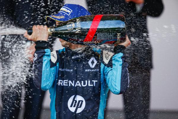 2016/2017 FIA Formula E Championship. Monte-Carlo, Monaco Saturday 13 May 2017. Sebastien Buemi (SUI), Renault e.Dams, Spark-Renault, Renault Z.E 16, sprays the champagne on the podium. Photo: Alastair Staley/LAT/Formula E ref: Digital Image _X0W1369