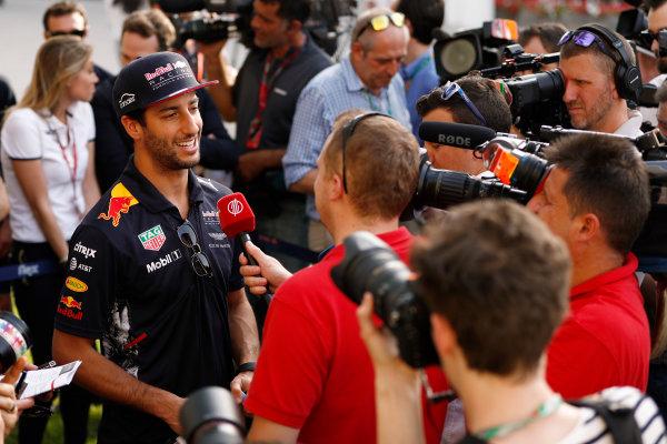 Bahrain International Circuit, Sakhir, Bahrain.  Thursday 13 April 2017. Daniel Ricciardo, Red Bull Racing, talks to the media in the paddock. World Copyright: Glenn Dunbar/LAT Images ref: Digital Image _X4I7120