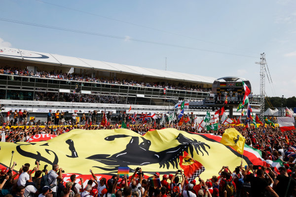 Autodromo Nazionale di Monza, Monza, Italy. Sunday 7 September 2014. Ferrari fans unfurl a giant flag after the race. World Copyright: Charles Coates/LAT Photographic. ref: Digital Image _J5R2272