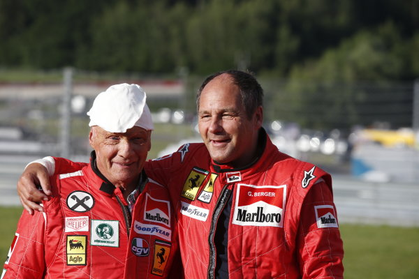 Red Bull Ring, Spielberg, Austria. Saturday 21 June 2014. Niki Lauda, Non-Executive Chairman, Mercedes AMG and Gerhard Berger. World Copyright: Charles Coates/LAT Photographic. ref: Digital Image _N7T3778