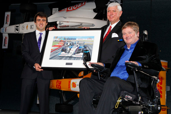 6 December, 2012, Indianapolis, Indiana USA Indy Lights champion Tristin Vautier with Al Speyer and Sam Schmidt and a original painting by Jim Swintal.(c)2012, Russell LaBounty LAT Photo USA .
