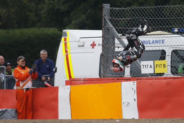 2015 Moto2 Championship.  British Grand Prix.  Silverstone, England. 28th - 30th August 2015.  Johann Zarco, Kalex, celebrates victory with a backflip off the tyre barrier.  Ref: KW7_7732a. World copyright: Kevin Wood/LAT Photographic