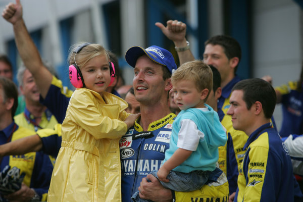 TT Circuit Assen, Netherlands. 28th June 2008.MotoGP Race.Colin Edwards Tech 3 Yamaha is joined in parc ferme by his kids.World Copyright: Martin Heath / LAT Photographicref: Digital Image Only