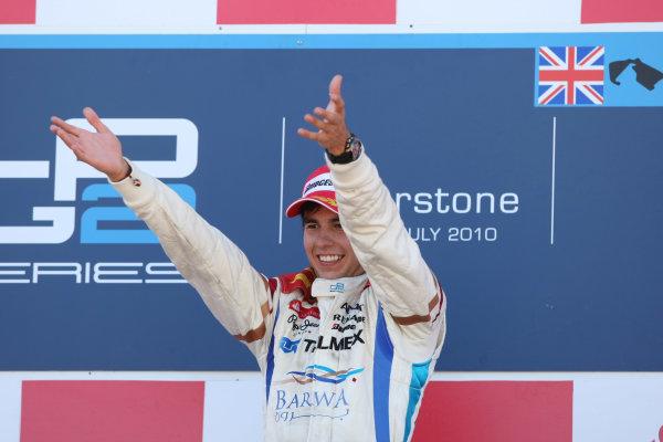 Silverstone, England. 11th July.Sunday Race. Sergio Perez (MEX, Barwa Addax Team) celebrates his victory on the podium. Photo: Jakob Ebrey/GP2 Media Service.Ref: _MKO_9329 jpg