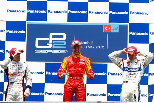 Round 3 Istanbul Park, Istanbul Turkey 30th May. Sunday Race.Dani Clos (ESP, Racing Engineering) celebrates his victory on the podium with Luiz Razia (BRA, Rapax) and Giedo Van der Garde (NED, Barwa Addax Team). Photo: Glenn Dunbar/GP2 Media Service.Ref: _G7C4908 jpg