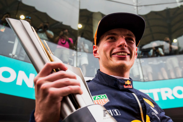 Sepang International Circuit, Sepang, Malaysia. Sunday 1 October 2017. Max Verstappen, Red Bull, 1st Position, celebrates with his team and his trophy. World Copyright: Zak Mauger/LAT Images  ref: Digital Image _56I3735
