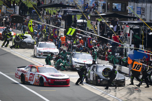 #18: Riley Herbst, Joe Gibbs Racing, Toyota Supra Monster Energy and #21: Kaz Grala, Richard Childress Racing, Chevrolet Camaro HotScream make pit stops