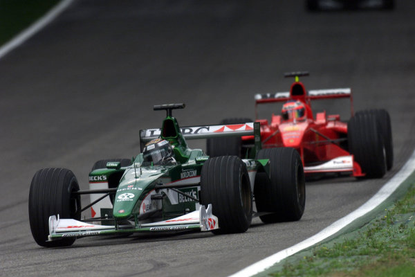 2000 German Grand Prix.Hockenheim, Germany.28-30 July 2000.Eddie Irvine (Jaguar R1) is followed by Rubens Barrichello (Ferrari F1-2000).World Copyright - Bellanca/LAT Photographicref 5mb Digital: Qualifying.