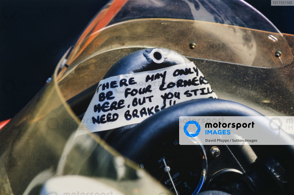 An amusing message is left above the steering wheel of a McLaren M23:
