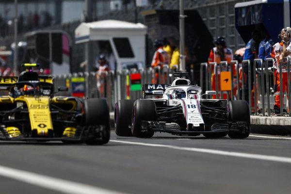 Carlos Sainz Jr., Renault Sport F1 Team R.S. 18, and Lance Stroll, Williams FW41