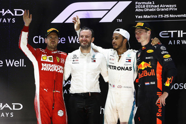 Sebastian Vettel, Ferrari, 2nd position, Bradley Lord, Communications Director, Mercedes, Lewis Hamilton, Mercedes AMG F1, 1st position, and Max Verstappen, Red Bull Racing, 3rd position, on the podium
