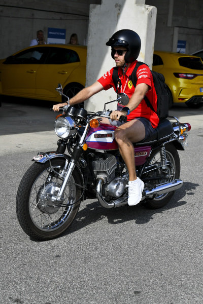 Sebastian Vettel, Ferrari arrives on his motorbike
