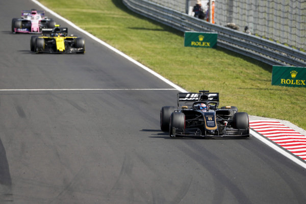 Romain Grosjean, Haas VF-19, leads Nico Hulkenberg, Renault R.S. 19, and Sergio Perez, Racing Point RP19