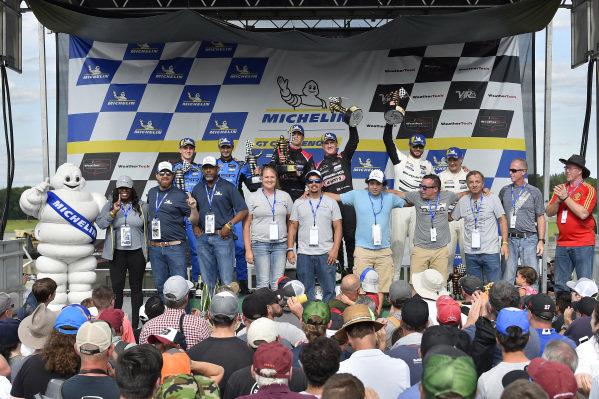 #33 Mercedes-AMG Team Riley Motorsports Mercedes-AMG GT3, GTD: Ben Keating, Jeroen Bleekemolen, #86 Meyer Shank Racing w/ Curb-Agajanian Acura NSX GT3, GTD: Mario Farnbacher, Trent Hindman, #63 Scuderia Corsa Ferrari 488 GT3, GTD: Cooper MacNeil, Toni Vilander and Michelin guests celebrate on the podium