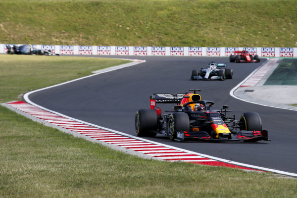 Max Verstappen, Red Bull Racing RB15, leads Lewis Hamilton, Mercedes AMG F1 W10, and Charles Leclerc, Ferrari SF90