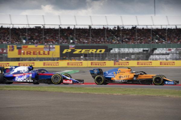 Lando Norris, McLaren MCL34, leads Alexander Albon, Toro Rosso STR14