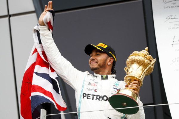 Race winner Lewis Hamilton, Mercedes AMG F1 on the podium with the trophy and a flag