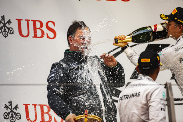 Nico Rosberg, 2nd position, sprays Ron Meadows with champagne on the podium.