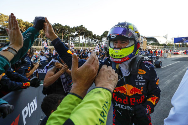 Sergio Perez, Red Bull Racing, 1st position, celebrates on arrival in Parc Ferme