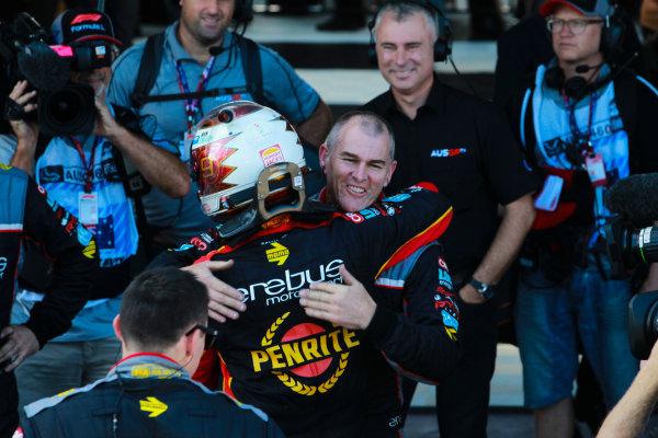 David Reynolds, Erebus Motorsport Holden, celebrates victory with his team.