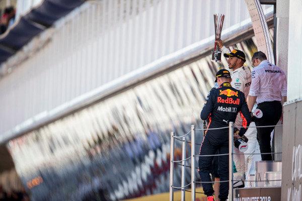 Lewis Hamilton, Mercedes AMG F1, 1st position, lifts his trophy.