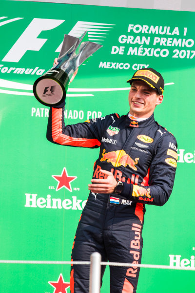 Autodromo Hermanos Rodriguez, Mexico City, Mexico. Sunday 29 October 2017. Max Verstappen, Red Bull Racing, raises his winner's trophy on the podium. World Copyright: Sam Bloxham/LAT Images  ref: Digital Image _W6I1348