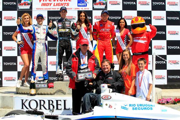13-15 April, 2012, Long Beach, California USAFirestone's Al Speyer presents Sam Schmidt with the winning owner trophy.(c)2012, Phillip AbbottLAT Photo USA