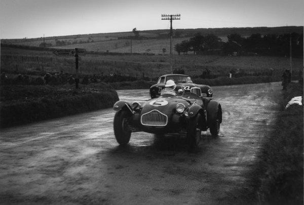 Dundrod, Northern Ireland. 16th September 1950 Ken Watkins (Allard J2), 18th position, leads Lance Macklin (Aston Martin DB2), 8th position, action. World Copyright: LAT Photographic Ref:  50 - 35 - 18.