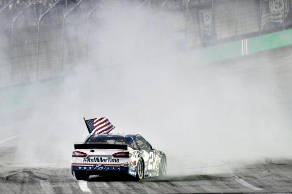 27-28 June, 2014, Sparta, Kentucky USA Brad Keselowski celebrates his win with a burnout ?2014, Nigel Kinrade LAT Photo USA