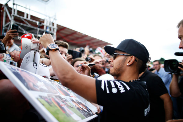 Spa-Francorchamps, Spa, Belgium. Thursday 20 August 2015. Lewis Hamilton, Mercedes AMG, signs autographs for fans. World Copyright: Glenn Dunbar/LAT Photographic ref: Digital Image _89P1761