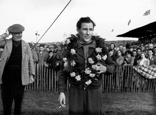 Dundrod, Northern Ireland. 15th August 1951.Stirling Moss (C-Type Jaguar), 1st position, podium, portrait.World Copyright: LAT Photographic.