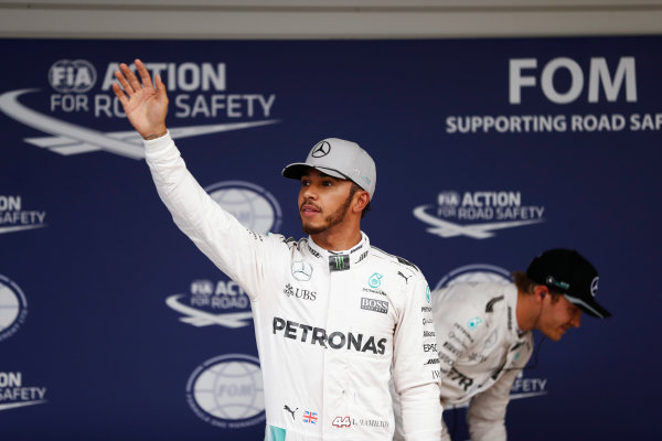 Suzuka Circuit, Japan. Saturday 08 October 2016. Lewis Hamilton, Mercedes AMG, celebrates his second place in qualifying in parc ferme, with pole winner Nico Rosberg, Mercedes AMG.  World Copyright: Glenn Dunbar/LAT Photographic ref: Digital Image _31I5417