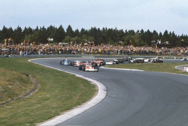 1976 German Grand Prix. Nurburgring, Germany. 30th July -1st August 1976. James Hunt (McLaren M23 Ford) leads the rest of the field at the start. World Copyright - LAT Photographic.