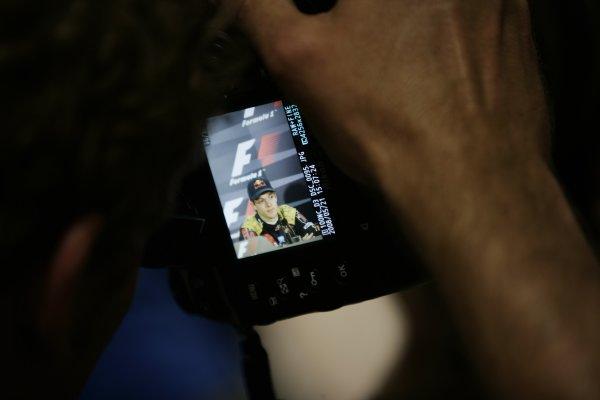 2008 Monaco Grand Prix - Wednesday Monte Carlo, Monaco. 21st May 2008. A snapper takes a shot of Sebastien Bourdais, Toro Rosso STR03 Ferrari, in a Press Conference. Press Conferences. Portrait. Media.  World Copyright: Charles Coates/LAT Photographic. ref: Digital Image _K5Y9030