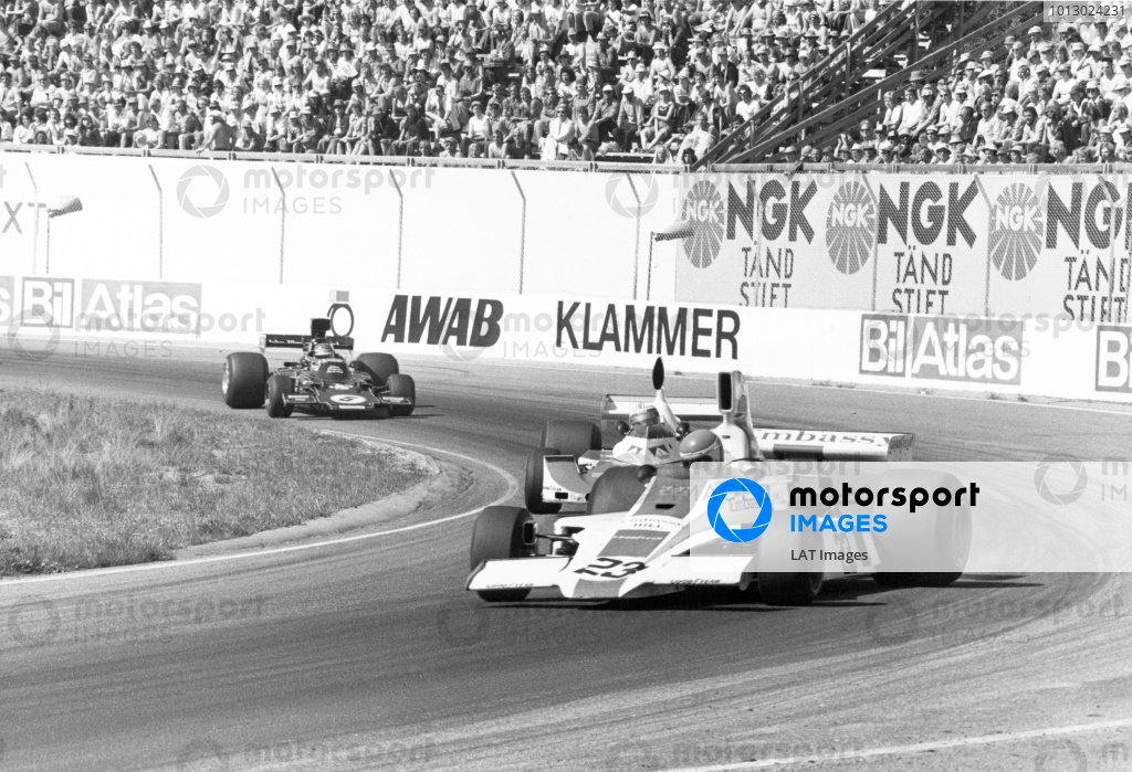 1975 Swedish Grand Prix.Anderstorp, Sweden. 8 June 1975.Tony Brise, Hill GH1-Ford, 6th position, leads Ian Scheckter, Williams FW04-Ford, retired, and Ronnie Peterson, Lotus 72E-Ford, 9th position, action.World Copyright: LAT Photographic
