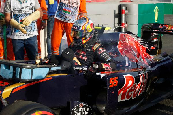 Baku City Circuit, Baku, Azerbaijan. Sunday 19 June 2016. Carlos Sainz Jr, Toro Rosso, retires from the race. World Copyright: Glenn Dunbar/LAT Photographic ref: Digital Image _W2Q9393