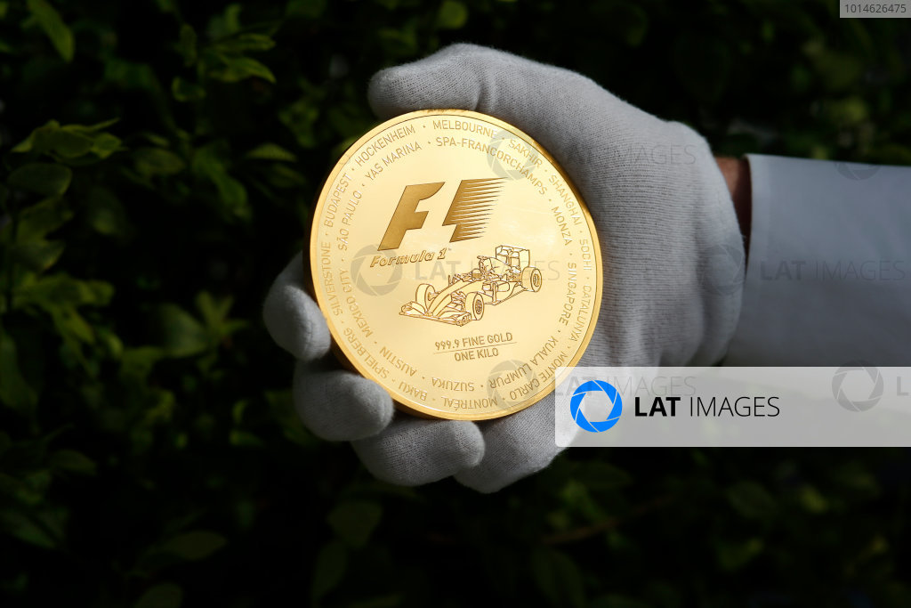Silverstone, Northamptonshire, UK Friday 8 July 2016. Rosland Capital launch their unique, limited collection of gold and silver F1 coins, celebrating the history the FIA Formula One World Championship. A special edition 1/4oz British GP Gold Coin is announced, as well as the introduction of their 1kg F1 Gold Coin -  one of only 15 to be made this year. In addition, they are also launching two other F1 coins: a 2.5oz Silver Coin and 2.5oz Gold Coin. World Copyright: FerraroLAT Photographic ref: Digital Image _FER0197